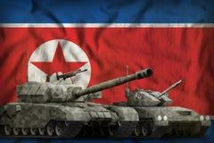 Nordkorea-Panzertruppenkonzept der Demokratischen Volksrepublik Korea auf dem Staatsflaggehintergrund Abbildung 3D Lizenzfreie Stockfotos