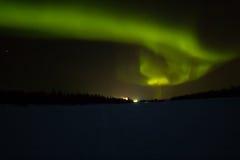 Nordliga ljus över Lapland Arkivfoto