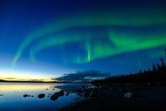 Nordliga ljus efter solnedgång Royaltyfri Bild