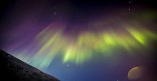 Nordliga ljus med linssignalljuset Royaltyfri Fotografi