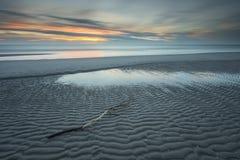 Nordsjönsolnedgång i lång exponering Arkivbild