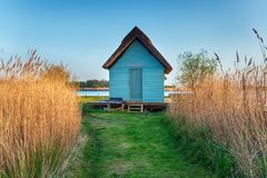 Norfolk Broads boat House. A boat house in the reeds near Horsey on the Norfolk Broads stock image