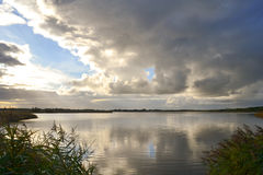 Norfolk Broads. Clouds reflecting in the water at Hickling Broad, Norfolk Stock Photography