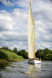 Norfolk Broads sail boat sailing on a river Stock Images
