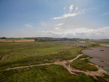 Norfolk coast line, sunny day 30 metres from the beach. Norfolk coast line, sunny day at the beach taken with a drone at 80 metres in the sky, blue skies Stock Photos
