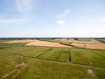 Norfolk coast line, sunny day 30 metres from the beach. Norfolk coast line, sunny day at the beach taken with a drone at 80 metres in the sky, blue skies Royalty Free Stock Image