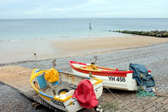 Norfolk Coast. Sheringham, Norfolk, UK. September 27, 2016.  Two fishing boats berthed on the slipway of Norfolk coast beach looking out to the North sea Royalty Free Stock Photo