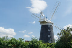 Norfolk coastline blue sky background with a windmill in the middle Royalty Free Stock Images