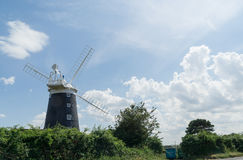 Norfolk coastline blue sky background with a windmill in the middle Stock Photos