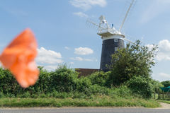 Norfolk coastline blue sky background with a windmill in the middle Royalty Free Stock Photo