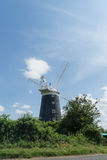 Norfolk coastline blue sky background with a windmill in the middle Stock Photography