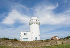 Norfolk coastline, lighthouse and blue skies Stock Photo