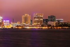 Norfolk - distant skyline. At night. Norfolk, Virginia, USA stock photography