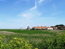 Norfolk landscape. With Cley Windmill in the background on a summer's day Royalty Free Stock Photo