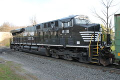 Norfolk Southern Locomotive 8118. Norfolk Southern Railroad Locomotive 8118 serves as a DPU on a eastbound train Stock Photos