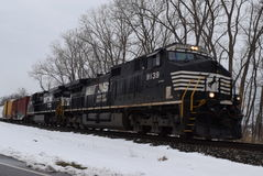 Norfolk Southern Train Traveling through Snow Stock Photography