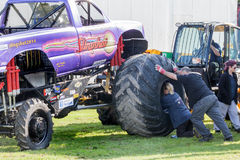Monster truck Slingshot wheel being put on Royalty Free Stock Photo