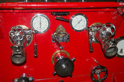 Dials and valves on vintage fire engine Royalty Free Stock Photo