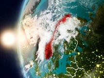 Norge under solnedgång på jord Arkivbild