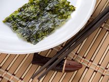 Nori seaweed on a plate Stock Images