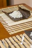Nori seaweed sheet with rice above to make sushi Royalty Free Stock Photo