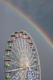 Noria y arco iris Imágenes de archivo libres de regalías