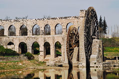 Norias of Hama. The Norias of Hama are a number of norias (wheels of pots) along the Orontes River in the city of Hama, Syria Royalty Free Stock Photos