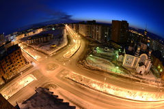 Norilsk fish-eye. Kirov street and the Church of the spring nigh Royalty Free Stock Photography