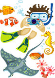 Norkeling man with photo camera and exotic fishes Stock Photos