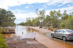 Normal car waiting at flooded road. Car next to flooded road waiting untill waterlevel drops. Captured during rain season in Western Australia Royalty Free Stock Photos