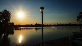 The normal evening of the normal sunset reflects the lake. The peaceful place where I used to stay in the evening in my village Royalty Free Stock Photography