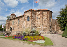 Norman Castle in Colchester. Eleventh century Norman castle in Colchester in springtime and UK flag Royalty Free Stock Images