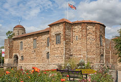 Norman Castle in Colchester in spring. 11th century Norman castle in Colchester in springtime and UK flag Royalty Free Stock Photo