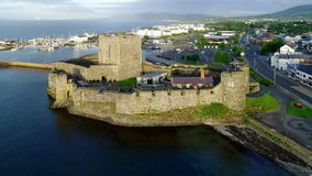 Norman castle and marina in Carrickfergus near Belfast, Northern Ireland, UK stock video footage