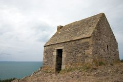 Normandie-An old home on the coastline. This is an example of many ruins that are touristic attractions in northern  French Stock Image