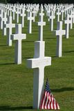 Normandy American Cemetery. The white marble crosses in rows at the Normandy American Cemetery in Colleville-sur-Mer. The american flag has been placed near one Royalty Free Stock Images