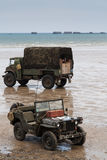 Normandy beach on D-Day anniversary. ARROMANCHES, FRANCE - JUNE 06, 2009:  Vehicles on Gold beach during the 65th anniversary of D-Day Stock Photo