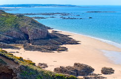 Normandy coast, France. Sand beach between the dark rocks on atlantic coast in Normandy, France stock photo