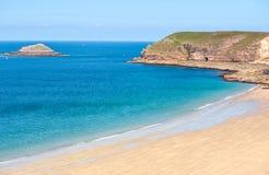 Normandy coast, France. Sand beach between the dark rocks on atlantic coast in Normandy, France stock photos
