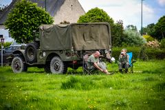 Normandy, France; 4 June 2014: Recreation of camp and rest of the campers with their military vehicle stock images