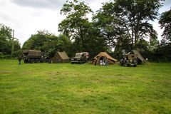 Normandy, France; 4 June 2014: View of recreation camp in Normandy for the 70th anniversary with vehicles and tents. Grass second world war ww2 wwii us army stock images