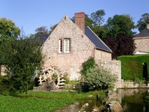 Normandy house, France. Typical Norman house with mill in northern France Royalty Free Stock Photography