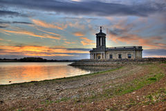 Normanton Chapel on lake shoreline Royalty Free Stock Image