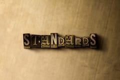 NORMES - plan rapproché de mot composé par vintage sale sur le contexte en métal Photographie stock libre de droits