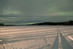 Norrsken i Inari, Lapland, Finland Arkivfoto