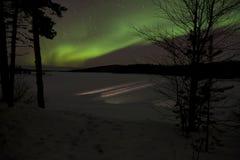 Norrsken i Inari, Lapland, Finland Royaltyfri Fotografi