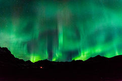 Norrthern Lights. Northern lights dancing above the mountains Stock Images