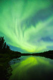 Nortehrn lights on the sky above river in Lapland. Colorful Nortehrn lights on the sky above river in Lapland royalty free stock photo