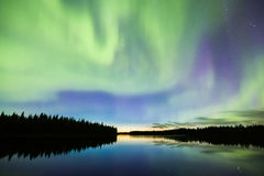 Nortehrn lights on the sky above river in Lapland. Colorful Nortehrn lights on the sky above river in Lapland royalty free stock photography