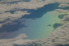 North of the Aegean sea and coast of Turkey saw from an airplane. Colors produced when light is passed through the airplane window royalty free stock photography